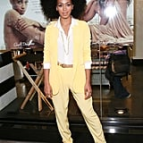Leave it to Solange to turn a business-ready ensemble on its head with bold color and sexy sandals. The songstress paired her yellow separates with a crisp white blouse, t-strap sandals, and white nail polish.