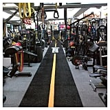 """Kim Kardashian pumped herself up for a workout with this empty gym shot. Kim's caption? """"Let's go . . . """""""