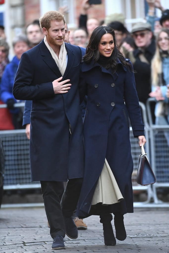 "Prince Harry and Meghan Markle stepped out for their first royal appearance in Nottingham, England, on Friday after announcing their engagement on Nov. 27. Meghan accompanied Harry for a visit to the Terrence Higgins Trust World AIDS Day charity fair, and they were as cute as can be as they held hands and rubbed each other's backs. The former Suits actress even bundled up in a navy coat that perfectly matched Harry's. Of course, their outing instantly took us back to Kate Middleton's first appearance with Prince William in 2010, and we immediately noticed one major difference between the two outing.  Kate attended her first engagement when she accompanied William to a Christmas event for the Teenage Cancer Trust, and unlike Harry and Meghan, the couple did not show any PDA whatsoever. Despite contrary belief, there is no protocol that states that British royal family can't show PDA, but since Will and Kate are ""working representatives of the British Monarchy,"" it's safe to assume that they just prefer to keep things professional during their official engagements. Still, that doesn't mean their outing was any less adorable. Keep reading for a look at Meghan and Kate's first royal engagements, side by side."