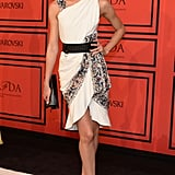 Candice Swanepoel got flirty with a white printed one-shouldered minidress by Prabal Gurung, then edged things up with her black accessories.