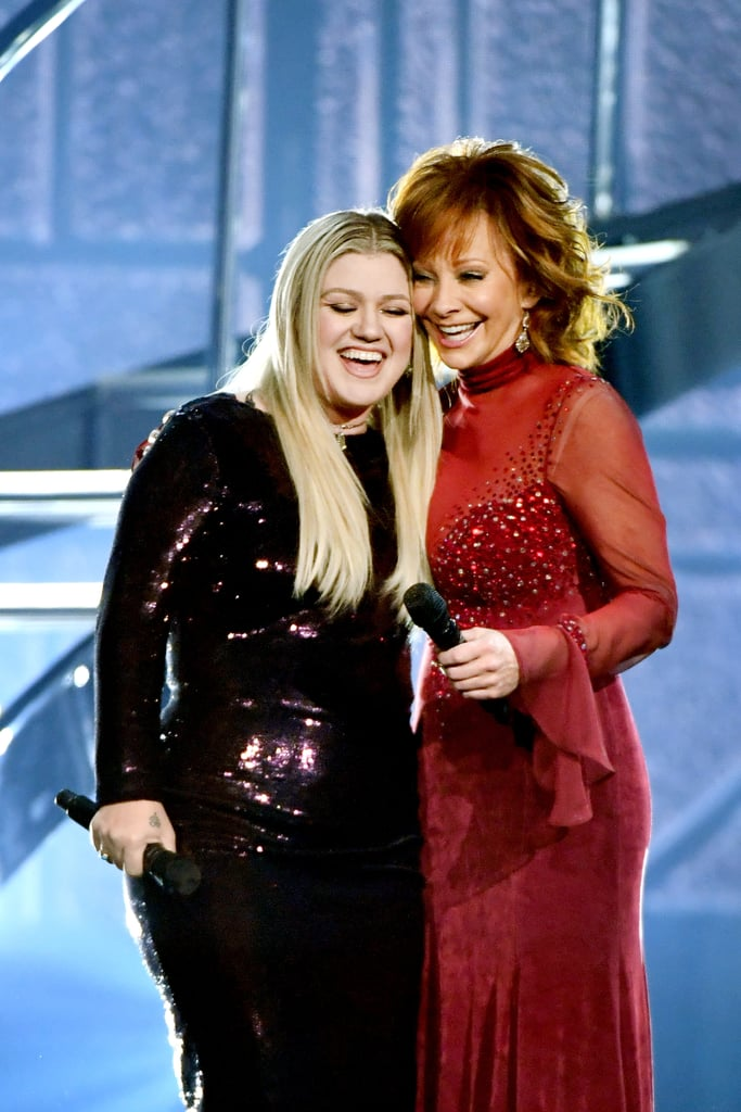 "Imagine having your music idol become your mother-in-law. Well, that's exactly what happened to Kelly Clarkson. After tying the knot with manager Brandon Blackstock in October 2013, the singer became a part of Reba McEntire's family. At the time, Reba was married to musician Narvel Blackstock, making her Brandon's stepmother. Though Reba and Narvel went on to divorce in 2015, she has stayed close with her former daughter-in-law. In fact, their friendship started way before Kelly and Brandon even started dating.  The two first performed together during a special of CMT Crossroads in 2007 and hit it off right away. After singing a country version of Kelly's hit song ""Because of You"" at the ACM Awards, the two joined forces for their North American tour, 2 Worlds 2 Voices Tour, a year later. Since then, they have shown off their bond at award shows and on stage. They recently reunited at the ACM Awards to sing Reba's ""Does He Love You?"" together. See some of their best moments together ahead."