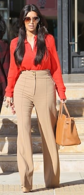 Designer of Kim Kardashian's Orange Blouse, Tan Trousers