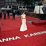 Keira struck a dramatic pose on the red carpet.