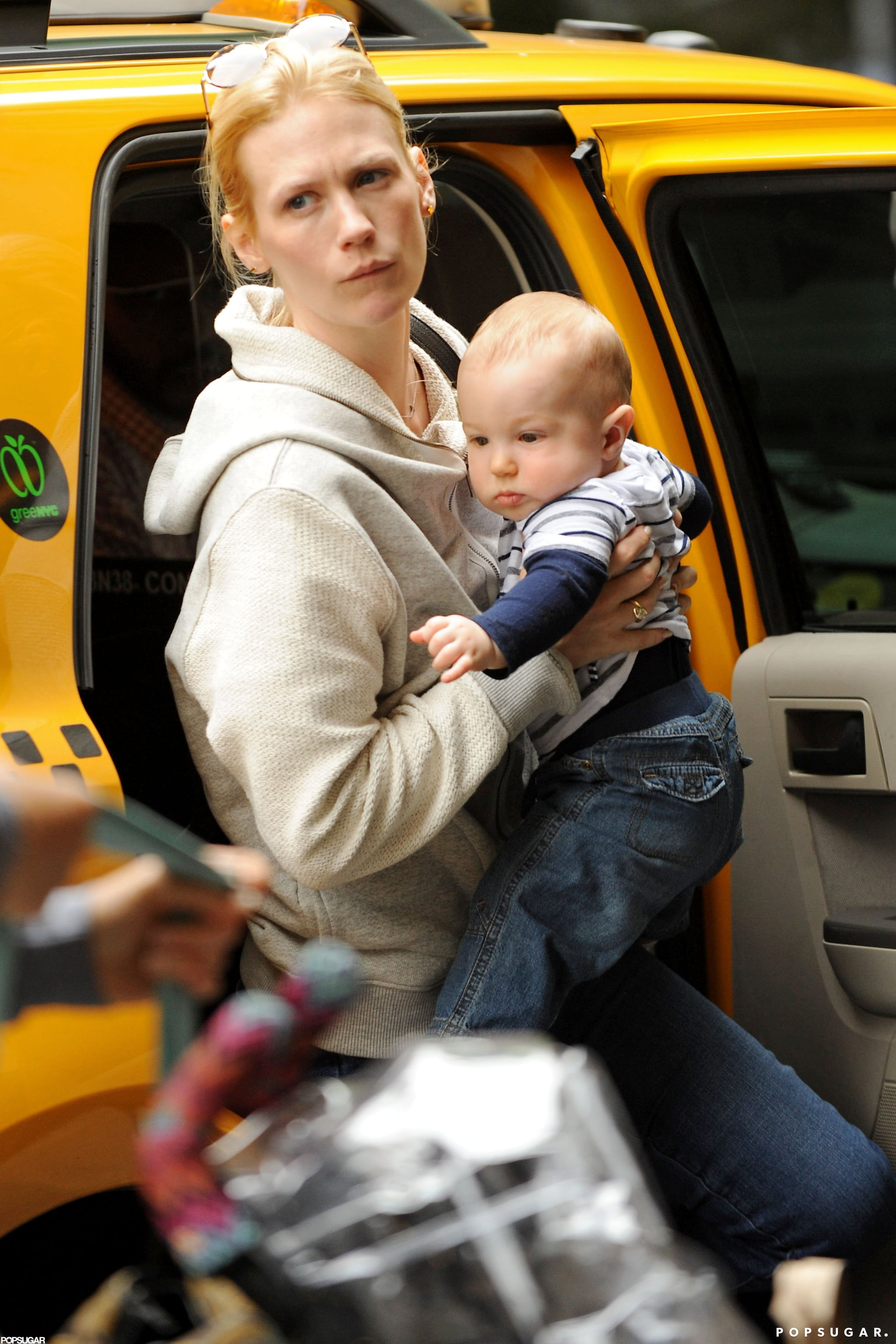 January Jones dressed baby Xander in a tiny pair of jeans and a striped shirt while out in NYC.