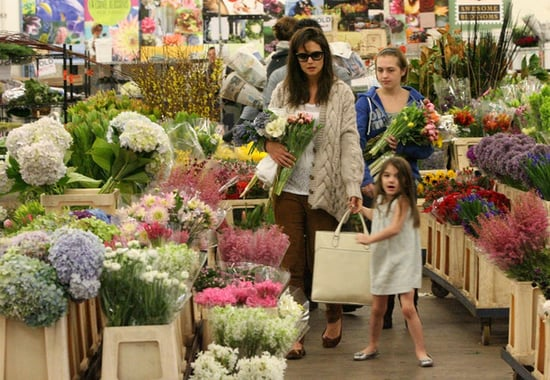 Katie Holmes and daughter Suri stock up on fresh flowers at a wholesale flower market in Downtown.