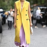 Carolina Issa mastered the art of being bold and ladylike by pairing a lavender maxi dress with a long, yellow vest.