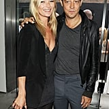 Kate Moss and Jamie Hince pose for cameras.