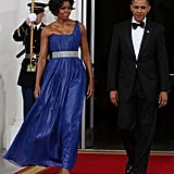 Michelle wearing a one-shoulder Peter Soronen gown at a state dinner in 2010.