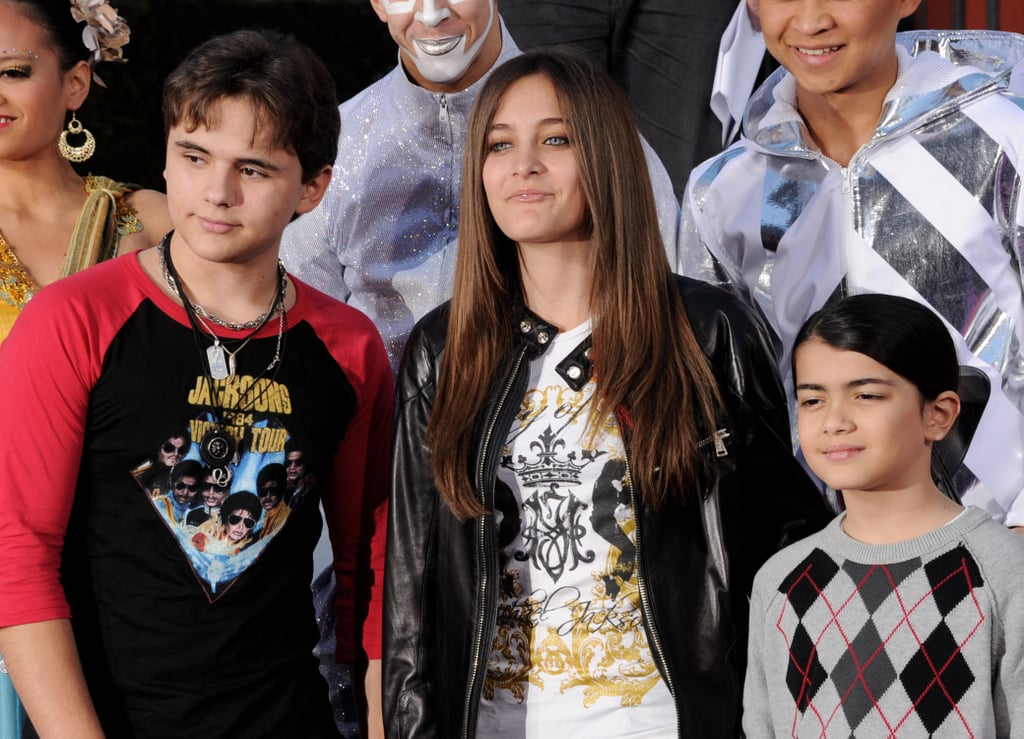 All three of Michael's kids: Prince, Paris, and Michael Jr. Fun fact: as Paris was born in 1998, Macaulay was the same age as she is now when he became her godfather.