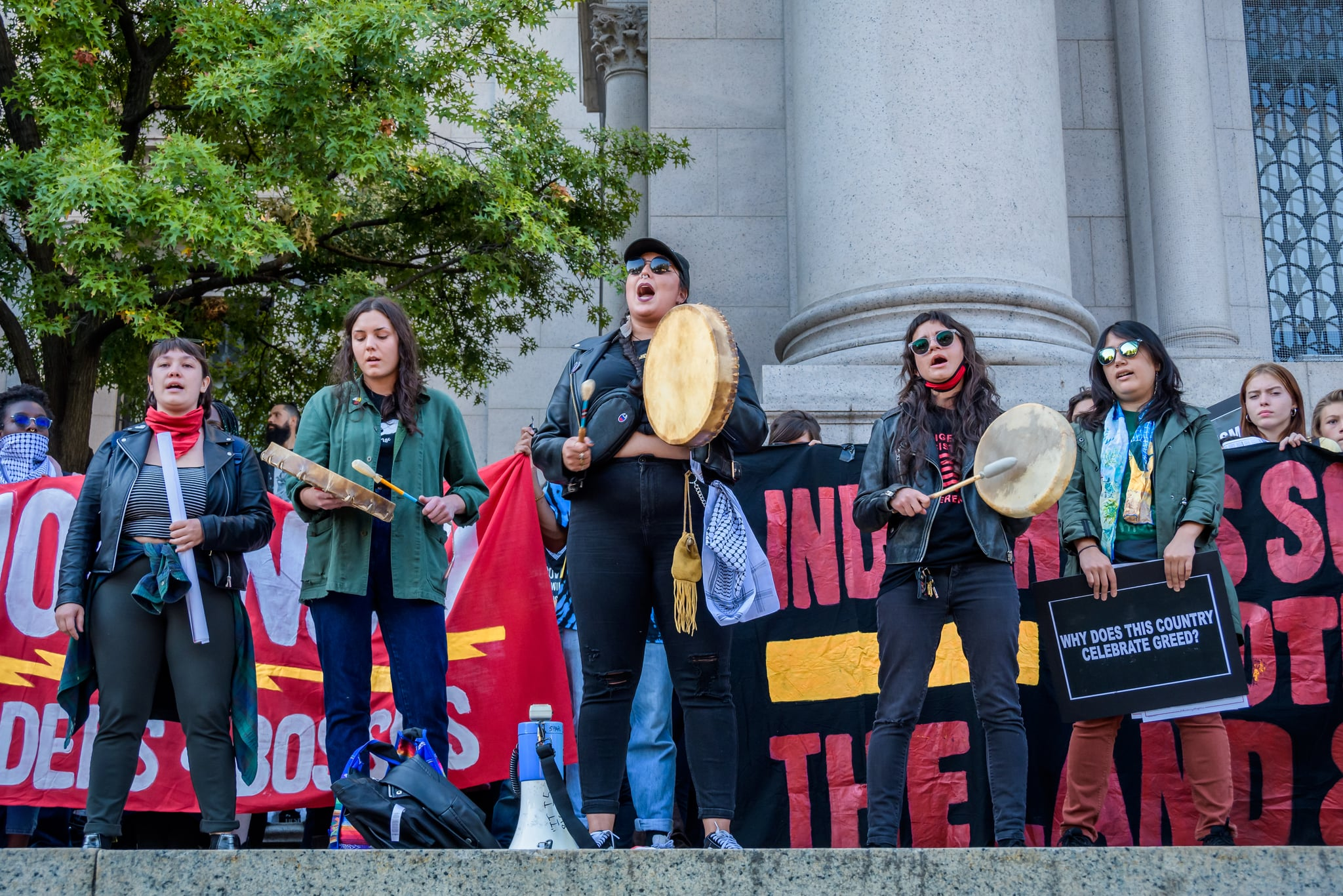 MANHATTAN, NEW YORK, UNITED STATES - 2019/10/14: Native Americans sharing a song with the crowd at the rally outside the American Museum of Natural History. Activist group Decolonize This Place and a citywide coalition of grassroots groups organized the fourth Anti-Columbus Day tour. The tour began at the Roosevelt Monument, and took to the streets moving into the city at large, joining together the movements for Decolonization, Abolition, Anti-Gentrification, and Demilitarization. (Photo by Erik McGregor/LightRocket via Getty Images)