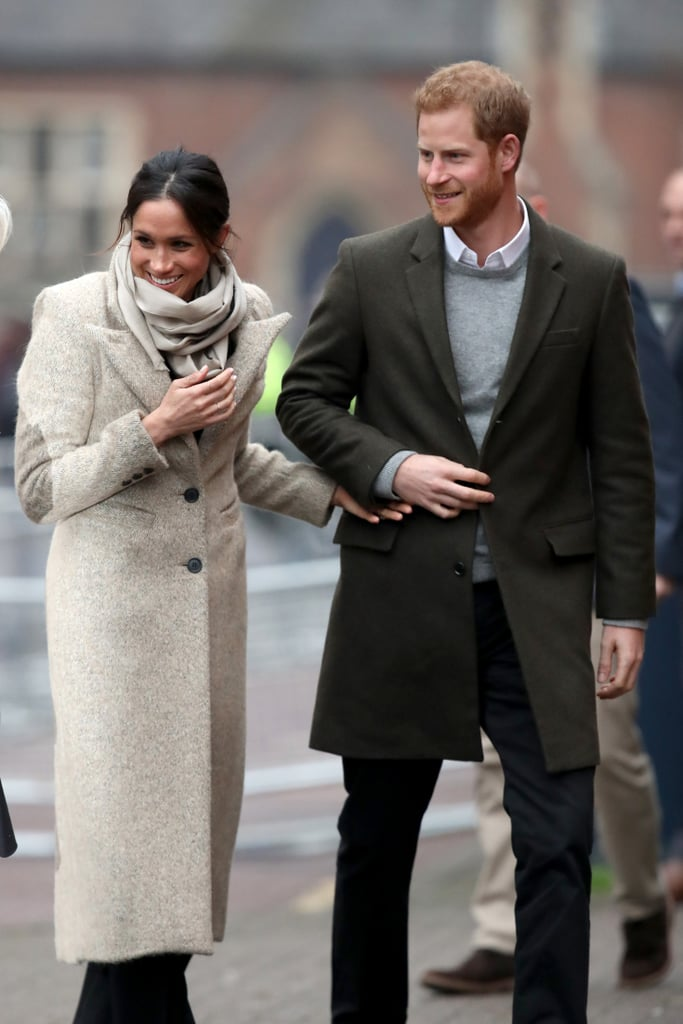 On Tuesday, Meghan Markle and Prince Harry made their first official public appearance of 2018 when they visited the studios of Reprezent 107.3 FM, an underground music station that supports young people through creative training. For the occasion, the royal fiancée wore a now-sold-out long Smythe coat over a black Marks & Spencer sweater, black Burberry high-waisted flares, and Sarah Flint shoes. She then accessorized her outfit with a Jigsaw scarf, three thin rings, a matching bracelet, and, of course, her stunning engagement ring. This isn't the first time that Meghan has been seen wearing this coat. Back in April 2016, she wore it in a different color while on the set of Suits with a pair of black ripped Paige jeans and Birdies slippers. Could she be taking a cue from Kate Middleton, who's known for recycling her royal gear? Read on to get a closer look at her outfit and shop similar coat options.      Related:                                                                                                           Meghan Markle Has a Wardrobe Full of Coats We're Sure Kate Middleton Would Love to Borrow