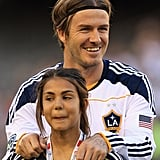 David Beckham held the shoulders of a fan.