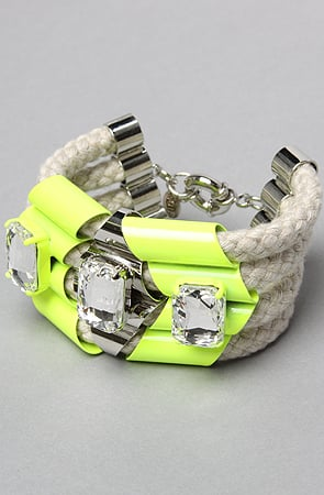 """""""Neon is a huge trend for summer, but it can be difficult to wear head to toe. This bracelet gives enough of a nod to neon without overdoing it. It'll look great with my Michael Kors watch!"""" — Ashley Madekwe Ashley's pick: nOir The Highlight Quad Rope Bracelet ($98)"""