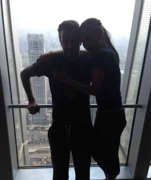 Victoria Beckham cuddled up to her husband, David Beckham, during downtime in Beijing. Source: Twitter user victoriabeckham