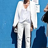 Et voilà! Jenna Lyons makes jeans and sneakers feel a lot more dressed up with a blazer thrown over the whole thing.