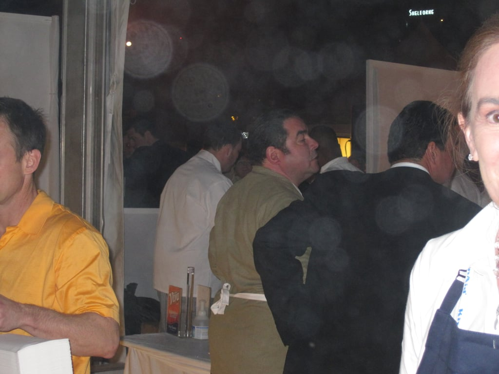 There's the host of the BubbleQ, Emeril Lagasse, busy making sandwiches.