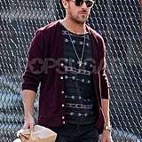 Ryan Gosling carried a brown paper bag and dined out for lunch in NYC.