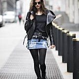 With a Black T-Shirt, a Denim Skirt, and a Leather Jacket