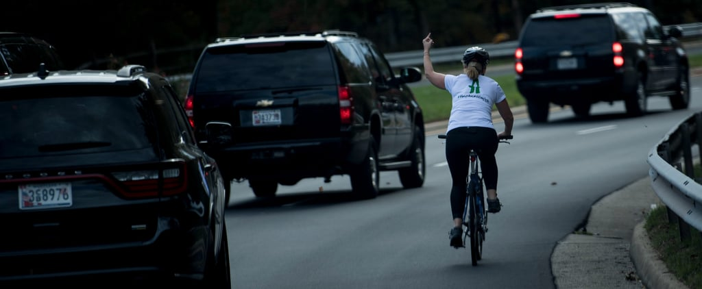 We Are Forever Indebted to This Cyclist Who Flipped Off Trump's Motorcade