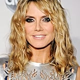 While Heidi usually sticks to straight styles, she wore her blond hair in mussed-up waves at the 2011 American Music Awards. And her eye makeup was a mix of silver and jet-black eyeliner.