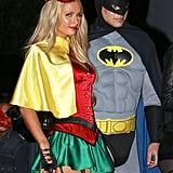 Paris Hilton and River Viiperi went as Batman and Robin.