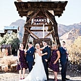 The bridesmaids in this wedding party donned purple and black printed dresses.