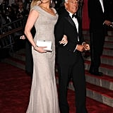 Julia arrived at the 2008 Met Gala on the arm of Mr. Armani, looking elegant in a Giorgio Armani Privé gown that she styled with a white evening clutch.