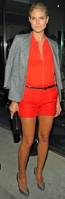 Heidi Klum in Orange Shirt and Shorts