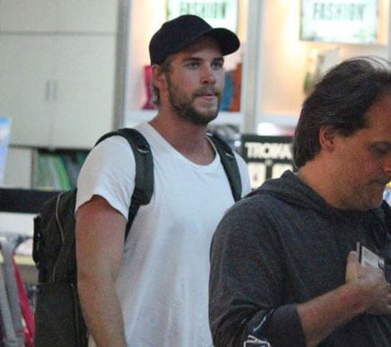 Liam Hemsworth went shopping in an airport store.