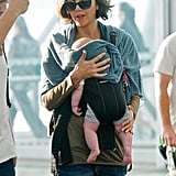 Maggie Gyllenhaal carried baby Gloria in her baby carrier to visit husband Peter Sarsgaard on the set of Very Good Girls in NYC.