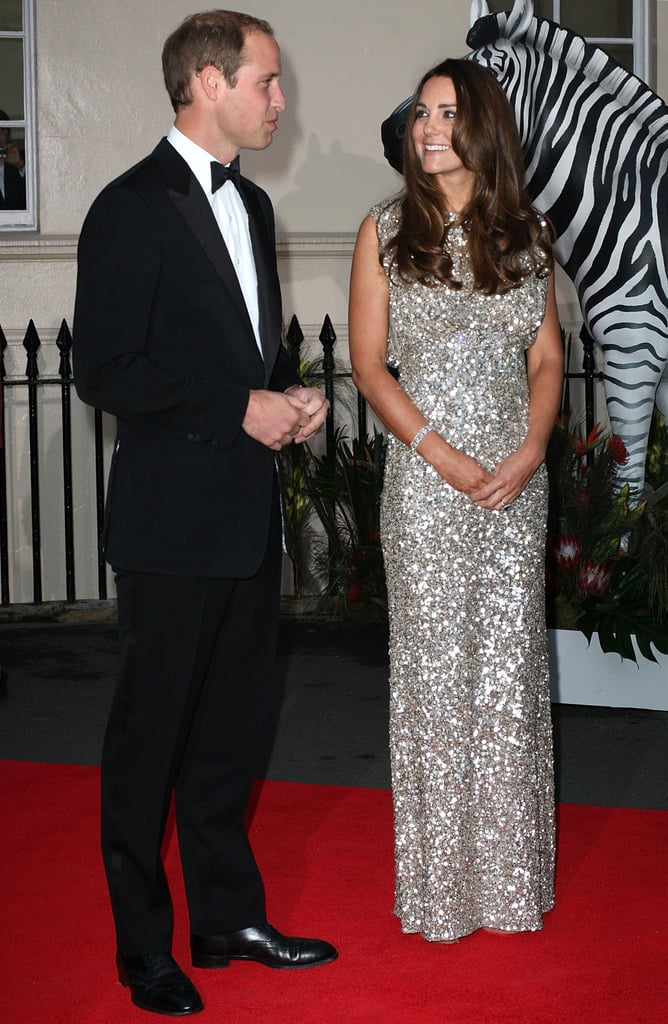"Kate Middleton got glamorous in a sparkling Jenny Packham gown to accompany her husband, Prince William, as guests of honour at tonight's inaugural Tusk Conservation Awards in London. William has a strong connection to the foundation, which aims to support a peaceful coexistence between Africa's people and its wildlife, since he became a Patron of Tusk back in December 2005. As a new father, he hopes to instill the same passion for Africa that he embodies in his newborn son, Prince William, which he shared in an interview that aired on CNN last month. After revealing that Prince George is a ""little rascal,"" Prince William went on to explain, ""I'll have toy elephants and rhinos around the room. We'll cover it in lots of bushes and things like that, make him grow up as if he's in the bush."" Kate switched gears for tonight's gala after making a casual pit stop at McDonald's during her road trip to Kensington Palace, for which Prince George was her passenger. She was also accompanied by a special helper for the drive — Prince William's former nanny, Jessie Webb, who has reportedly come out of retirement to lend her expertise in child rearing to the new parents. Today's royal appearance for the Tusk Conservation comes at a fitting time for Prince William, who officially ended his stint as a RAF search and rescue pilot, to dedicate his time to work in the field of conservation, as he has been named the president of a new collaboration, United For Wildlife."
