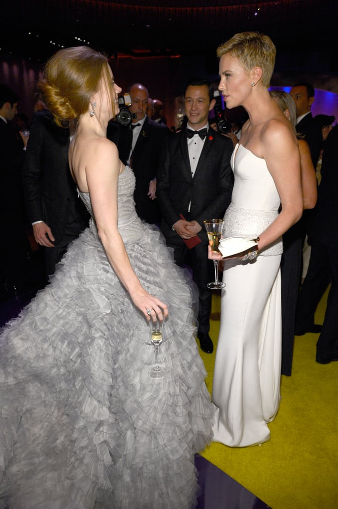 Amy Adams and Charlize Theron chatted at the Governors Ball.