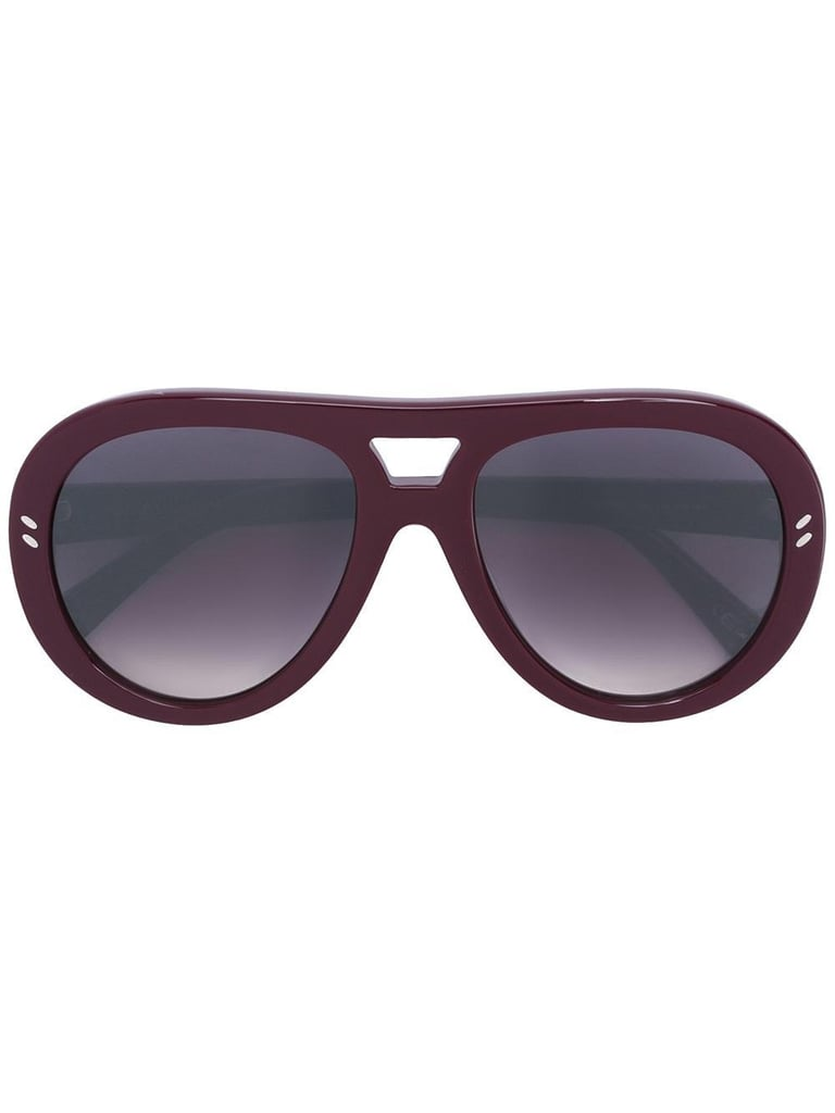 Go for a rich color in these ultra-flattering Stella McCartney Rounded Aviator Sunglasses ($285).