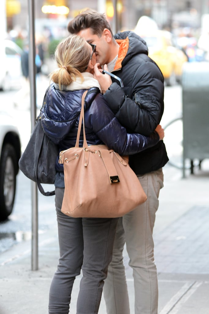 Scarlett Johansson and Romain Dauriac locked lips on the streets of NYC in December.