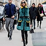 For Dior, Olivia slipped into a luxe and brightly hued coat to complement her black leather boots.