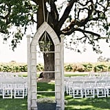 "Create your own ""outdoor chapel"" with standing arches at the end of the aisle, and then add a crystal chandelier to amp up the romance. Photo by Tanja Lippert Photography via Style Me Pretty"