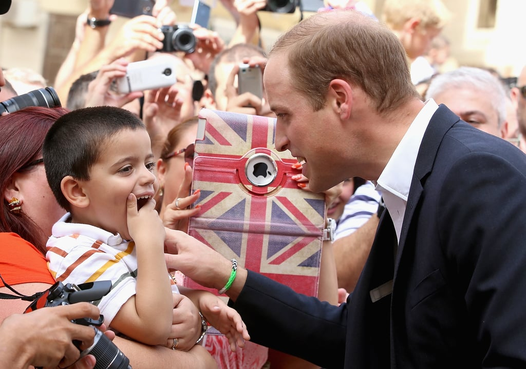 """Prince William stood in for his sick wife, the Duchess of Cambridge, over the weekend when he made a solo trip to Malta to attend to royal duties. Kate was initially slated to do the trip on her own, but she was forced to pull out at the very last minute due to her ongoing battle with hyperemesis gravidarum (severe morning sickness). The journey was to be the duchess's first solo overseas trip on behalf of Queen Elizabeth II. Luckily for Kate, her husband is an expert at royal journeys, and he won over the crowds with his sweet interactions with children both at events and at a local youth centre. On Sunday, Will stopped by Agenzija Appoogg to hang out with a group of teenagers and show off both his foosball and video game skills. He helped secure a victory at table football with two other teen guests, and later played a football video game on an XBox 360 with a group of boys. (Both Prince Harry and William are avid gamers, although Will has previously revealed that Kate was against the idea of him getting a Playstation 4 back in 2013 because """"it's very addictive."""") In addition to attending various events in Malta, William also took time to update everyone on his wife's condition. He said that Kate is feeling """"so-so"""" and was disappointed that she couldn't go through with her visit. William also joked that the island nation was not yet ready for a visit from Prince George, adding that there are """"too many precious things around here."""" The prince wrapped up his trip on Sunday and is now back in England."""
