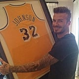 """David Beckham with the """"best birthday gift ever,"""" a Magic Johnson jersey."""
