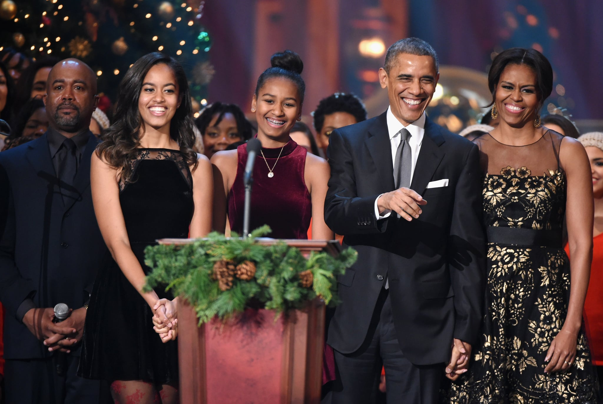 WASHINGTON, DC - DECEMBER 14:  (L-R) Darius Rucker, Malia Obama, Sasha Obama, U.S. President Barack Obama, and First Lady Michelle Obama speak onstage at TNT Christmas in Washington 2014 at the National Building Museum on December 14, 2014 in Washington, DC.  25248_001_0605.JPG  (Photo by Theo Wargo/WireImage)
