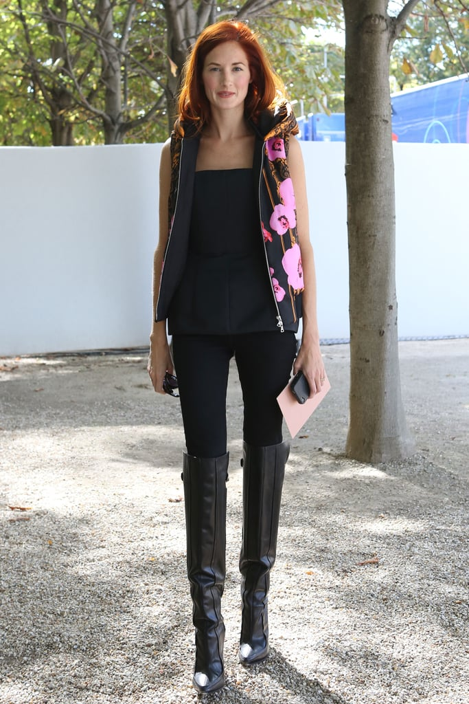 Taylor Tomasi Hill was street-styled perfection in a black peplum top and statement vest.