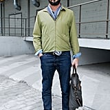 We have a tendency to throw on a t-shirt with our jeans, but dudes aren't the only ones who can polish up their bottoms with a button-up and a briefcase. Adopt the same style manifesto to transform skinny jeans from casual to office casual with a tailored button-down and a structured tote. 8391349 Source: Stylesight