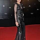 Freida Pinto wore a black gown with sheer sleeves to the opening night dinner at the Cannes Film Festival.