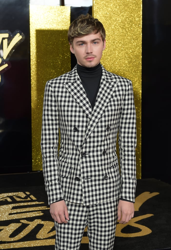 Basic black suits are so not Miles Heizer's cup of tea. The 13 Reasons Why star just took the MTV Movie & TV Awards red carpet sporting a black-and-white checkered suit, and we think we're in love. Miles paired his perfectly tailored suit with a matching turtleneck shirt and leather shoes, making for one show-stealing look. Ahead, catch a glimpse of the actor's cool outfit, and be sure to see the rest of the stunning red carpet ensembles.
