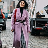 A belt cinched at the waist breathes new life into Caroline Issa's coat.