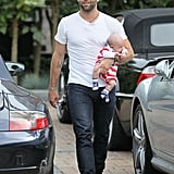 Jamie Mazur carried baby Noah on the Fourth of July in LA.