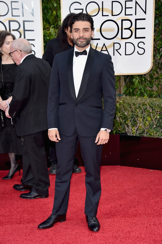 Oscar Isaac was one of the many stars on the Golden Globe Awards red carpet on Sunday evening. The Star Wars: The Force Awakens actor arrived solo on the red carpet but was joined by Aziz Ansari, Pedro Pascal, and his reported girlfriend, Elvira Lind. Inside, the handsome stud showed off his smouldering good looks and flashed a big smile when he won best actor in a miniseries or TV film for his role in HBO's Show Me a Hero. Read on to see more of Oscar's big night at the Golden Globes, and then flip through 34 of his photos that are guaranteed to awaken the Force within you.