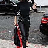 Giving us serious Selena Quintanilla vibes, Selena wore an embroidered red Coach bomber, Coach leather pants, and studded Stuart Weitzman heels.