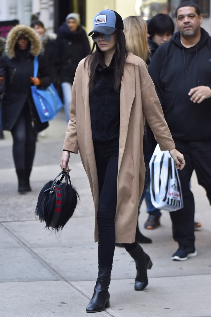4f7ca9799ae0c Kendall Jenner kept a low profile with a baseball cap and duster coat in NYC .