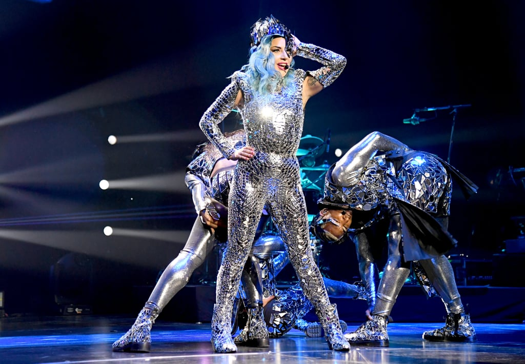 "Lady Gaga is living for the applause! On Feb. 1, the 33-year-old singer took the stage in Miami to perform at AT&T Super Saturday Night. Ahead of the Super Bowl, the pop star treated fans to an outlandishly glitzy show and sang her biggest hits, such as ""Just Dance,"" ""Bad Romance,"" and ""Born This Way."" And, of course, she crooned the song of 2018, ""Shallow."" However, to many fans' dismay, she didn't perform her secret tune ""Stupid Love,"" which leaked in January. In true Gaga form, the blue-haired songstress donned a few dazzling costumes, including an iridescent jumpsuit and a bodysuit with a green tulle adornment. She also wowed the crowd by suspending herself from the ceiling of the venue, Meridian at Island Gardens, à la her Super Bowl halftime performance in 2017. Check out photos and videos from her high-flying set ahead!      Related:                                                                                                           12 Phenomenal Lady Gaga Performances That Will Turn Anyone Into a Little Monster"