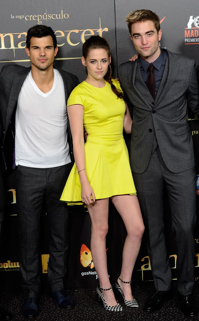 All eyes were on a neon-clad Kristen Stewart, in a Dior dress and Barbara Bui stilettos, at today's Madrid premiere of Breaking Dawn Part 2. She was joined by her constant red-carpet companions Taylor Lautner and Robert Pattinson for the latest leg of their international press tour. The trio flashed smiles for photographers before heading inside, where fans eagerly waited to screen the final installment in the Twilight franchise.  The film opens at midnight, and some analysts predict Breaking Dawn Part 2 will earn at least $130 million during opening weekend. So far, reviews have been less than glowing, but that isn't deterring die-hard fans from swooping up tickets. Before saying farewell to Edward, Bella, and the entire Cullen clan, be sure to catch up on all the films with our comprehensive recap of the entire Twilight Saga.